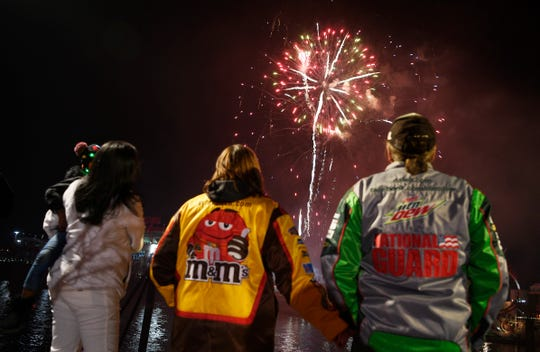 Fans watch fireworks at the end of the NASCAR Burnouts on Broadway.
