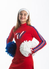 Jackie Pappas, the Gulf Coast High School cheerleader, poses for a portrait on Wednesday, December 4, 2019, in North Naples. She is going to London to ring in the new year as part of an All-American team.