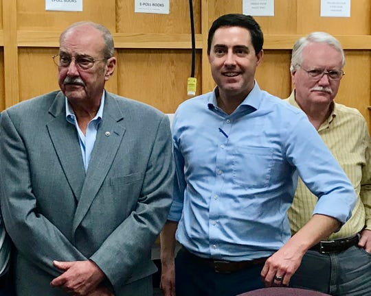 Ohio Secretary of State Frank Larose, flanked by Licking County Board of Elections board members Richard Salvage (right) and Larry Wise (left), discussed securing Ohio's elections during a visit to the local board of elections office.