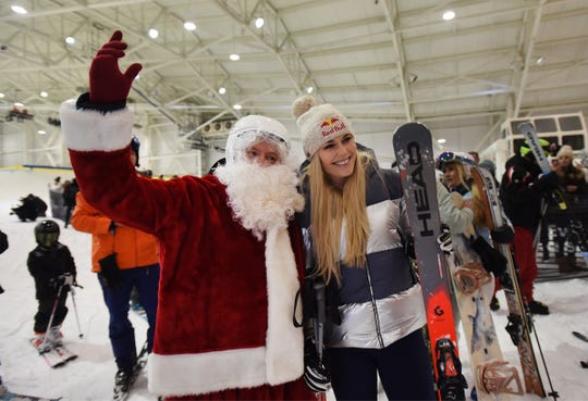 World Champion and Olympic Gold Medal ski racer Lindsey Vonn has her picture taken with Santa during the grand opening of Big SNOW American Dream in East Rutherford  on 12/05/19.