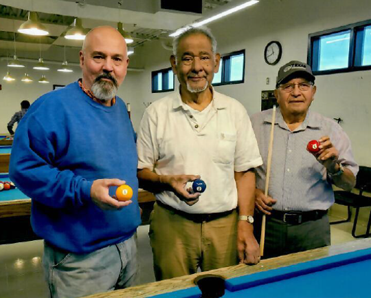 Kelly Smith, left, won first place in the Munson Senior Center Billiards Tournament in November. Jaime Chavando, middle, won second place and Florencio Avitia, right, won third place.
