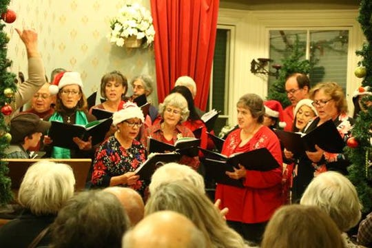 Silver Chorale performs in the parlor for Victorian Christmas 2018. Dominic Rasmussen on the left emceed the program as Tiny Tim. Both will be returning this year. A newly added puppet show will be in the Dodge Gallery earlier in the evening.