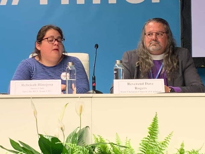 The Rev. David Rogers (left) and Rebekah Hinojosa, speak at the United Nations' Climate Change Conference, Dec. 4, 2019 in Madrid, Spain.