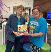 Betty Roberts , left,of the Federated Republican Women of Lincoln County presents books to a teacher at Sierra Vista Primary
