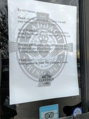 The sign on the door of the Claddagh in Livonia announcing its closure.