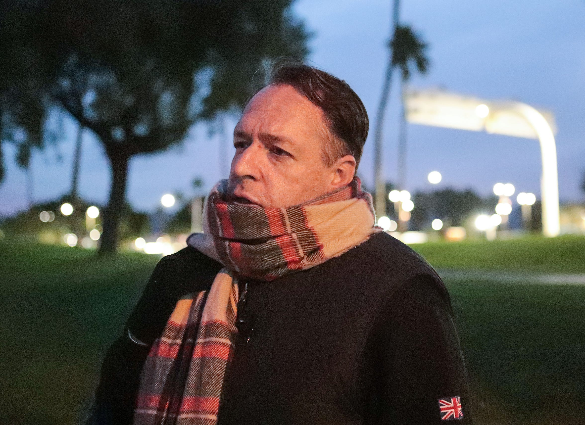 Philven Sitton waits for an early morning bus to take him to Well in the Desert where he volunteers in Palm Springs, December 2, 2019.
