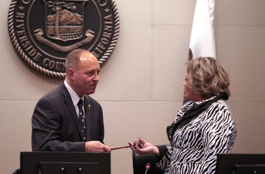 Indio Mayor Glenn Miller receives the gaval from Lupe Ramos Amith, the outgoing mayor, right,  during a ceremony Wednesday, Dec. 4, 2019, inside Indio's City Hall.