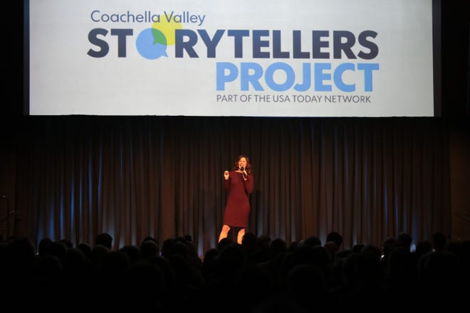 Desert Sun features editor Kristin Scharkey announces the next storyteller during the Coachella Valley Storytellers Project held at the Rancho Mirage Library in Rancho Mirage, Calif., on December 4, 2019.