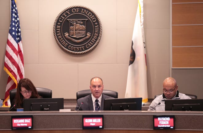 Mayor Glenn Miller, center, moves into the post at Indio City Hall in Indio, Calif., on December 4, 2019.