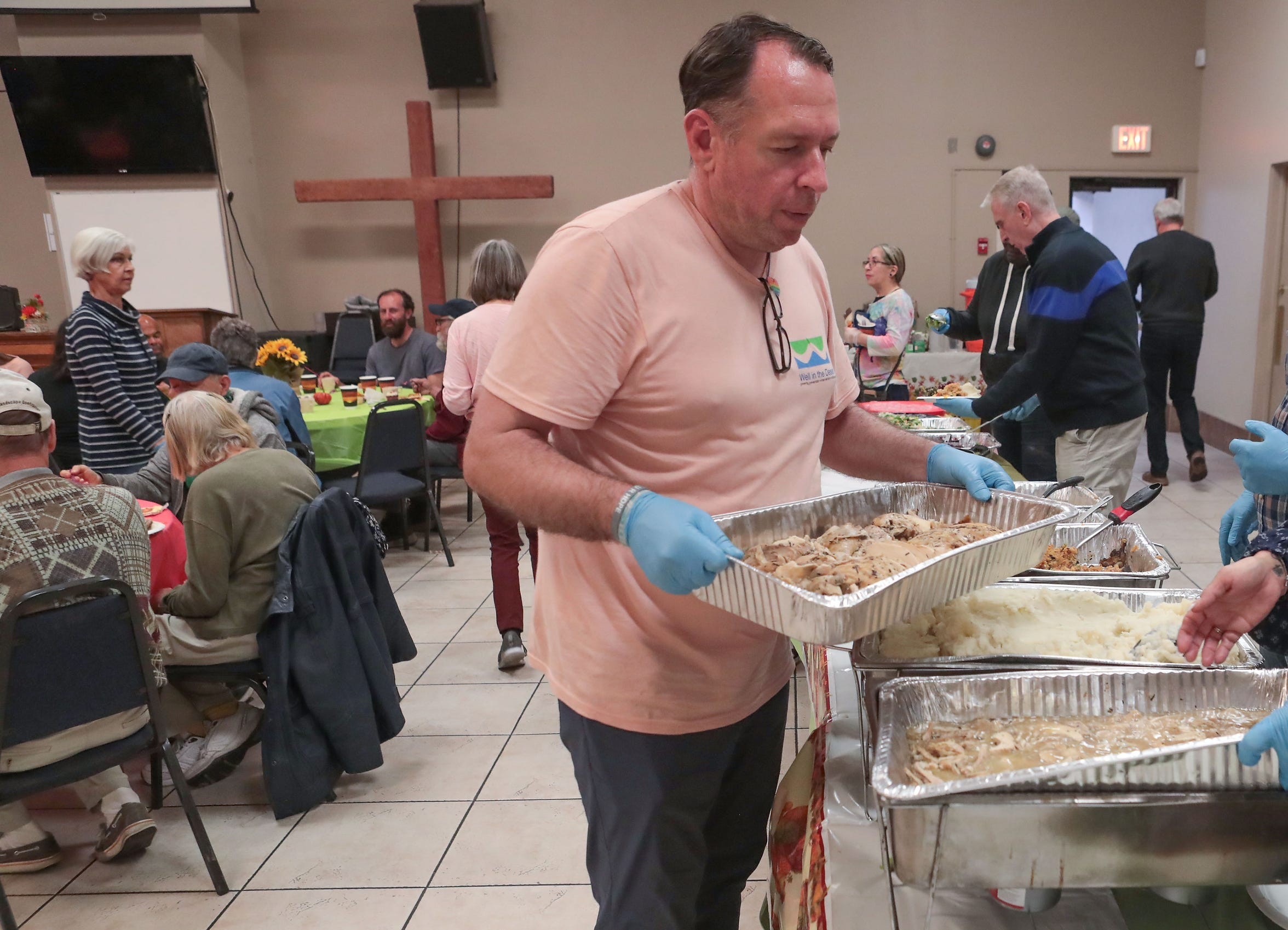 Philven Sitton volunteers with Well in the Desert as they serve Thanksgiving meals at Our Lady of Solitude Church in Palm Springs, November 28, 2019.