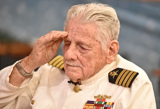 Retired Navy Captain Robert O'Neill, of Bradenton, a Pearl Harbor survivor shared some of his memories of Japan's sneak attack 75 years ago yesterday at Sarasota's VFW post #3233 located at 124 s. Tuttle. Here O'Neill, 92, salutes during the playing of taps Wednesday afternoon Dec. 7, 2016.