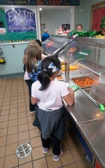 Students select their mealtime favorites during lunch at Scenic Heights Elementary School on Thursday, Dec. 5, 2019.
