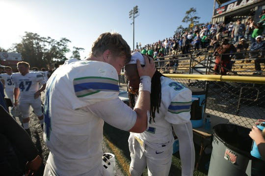 UWF quarterback Austin Reed (left) celebrates with Anthony Johnson Jr. (right) after his game-winning touchdown against No. 1 Valdosta State on Nov. 30, 2019.