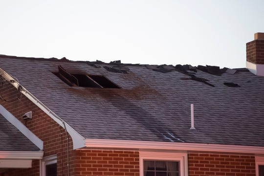 A hole is seen in the roof of a home that caught fire in the 1400 block of Baltimore Street in Penn Township Dec. 5, 2019. The fire started from a stove and spread up into the attic through the stove vent, according to Hanover Area Fire and Rescue Chief Tony Clousher.