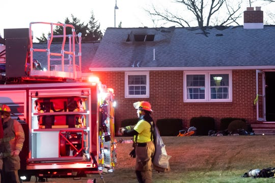 Firefighters work the scene after controlling a fire at a home in the 1400 block of Baltimore Street in Penn Township Thursday, Dec. 5, 2019.