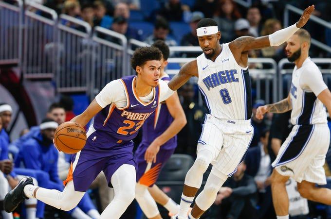 Dec 4, 2019; Orlando, FL, USA; Phoenix Suns forward Cameron Johnson (23) drives around Orlando Magic guard Terrence Ross (8) during the second quarter at Amway Center. Mandatory Credit: Reinhold Matay-USA TODAY Sports