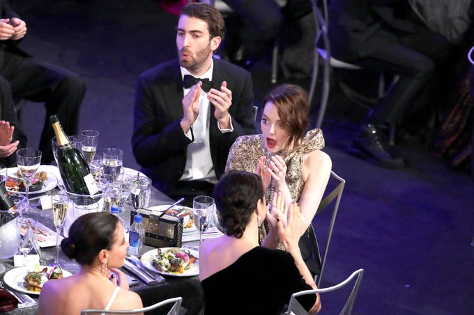 Emma Stone and Dave McCary react to a win at the Screen Actors Guild Awards on January 27, 2019 in Los Angeles.