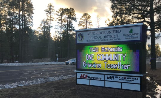 A sign showing support for the Rawlings family in Lakeside on Dec. 4, 2019. Two 5-year-old children were killed after the family attempted to cross Tonto Creek on Nov. 29, 2019. A 6-year-old girl remains missing.