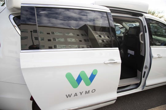 A passenger takes a ride in a Waymo self-driving car from The Element Hotel in Chandler on Dec. 3, 2019.