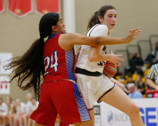 Desert Mountain's Sophie Gerber (31) puts a move on Arcadia's Vaita Felemi (24) during the 7th Annual Hoophall West in Scottsdale December 4, 2019.
