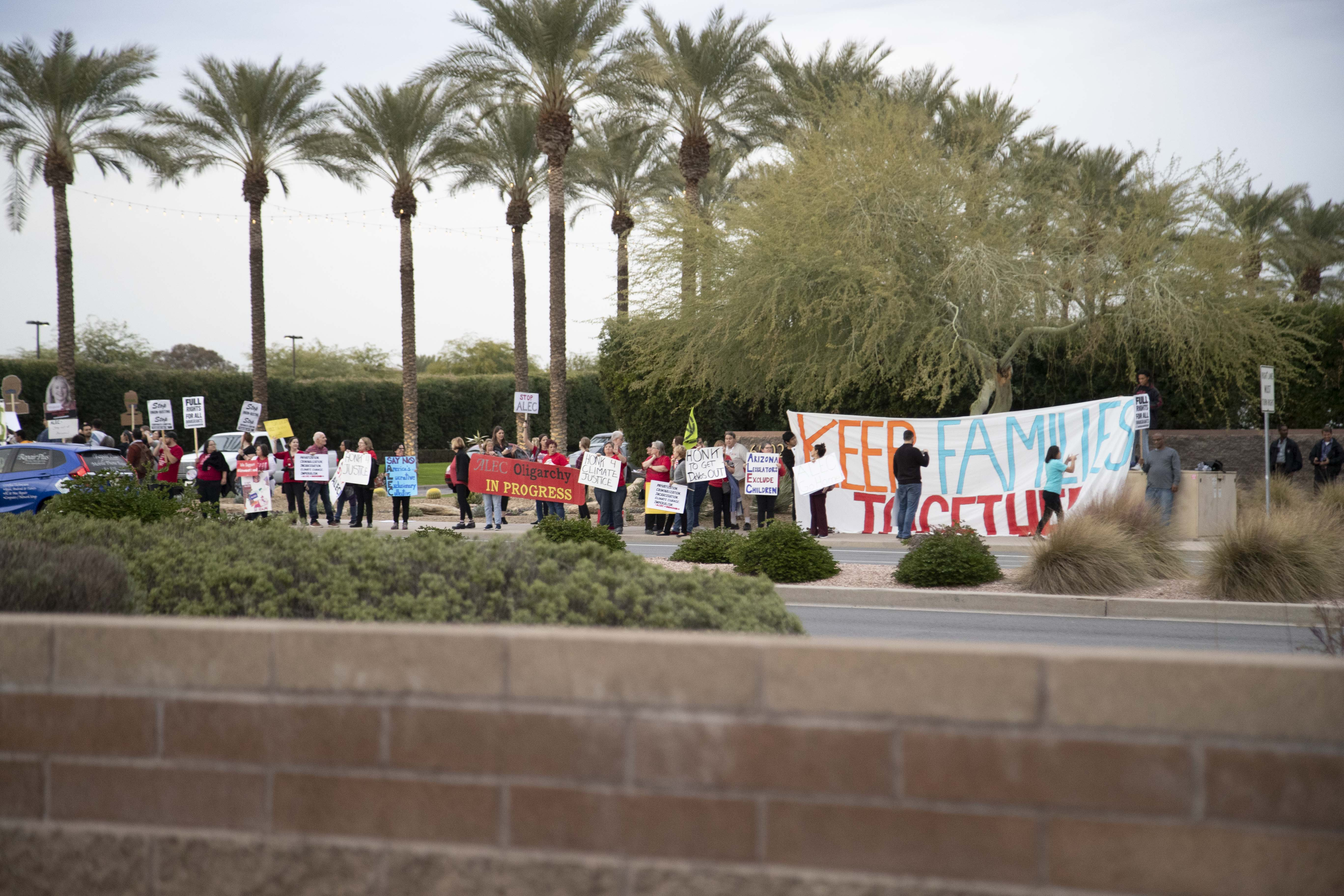 Arizona teachers and local residents protest ALEC meeting
