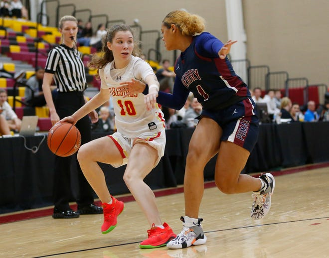 Chaparral's Jess Finney (10) is defended by Perry's Tatyanna Clayburne (1) during the 7th Annual Hoophall West in Scottsdale December 4, 2019.