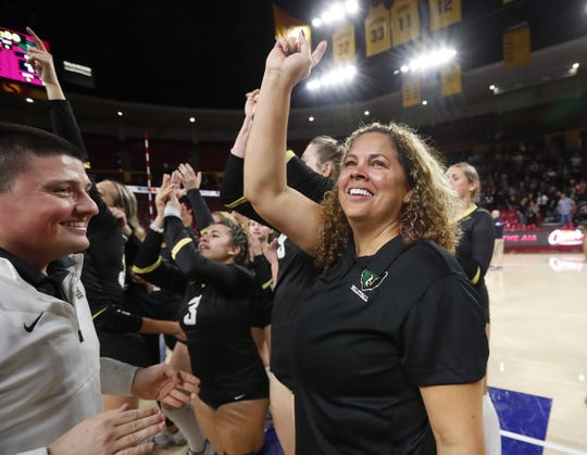Basha head coach Terri Spann celebrates after winning the 6A state volleyball championship against Perry at Desert Financial Arena in Tempe November 12, 2019.