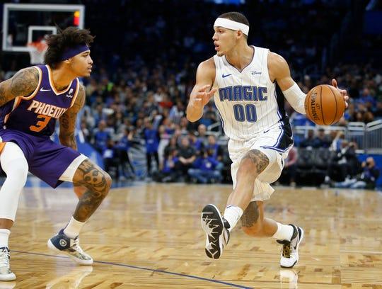 Dec 4, 2019; Orlando, FL, USA; Orlando Magic forward Aaron Gordon (00) drives toward Phoenix Suns forward Kelly Oubre Jr. (3) during the second quarter at Amway Center. Mandatory Credit: Reinhold Matay-USA TODAY Sports