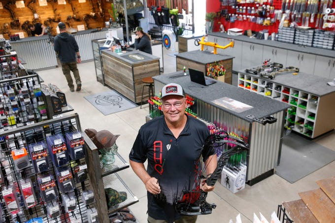 Archery Headquarters owner Randy Phillips stands in his Chandler store on Nov. 26, 2019. The specialty store has been open for 30 years.