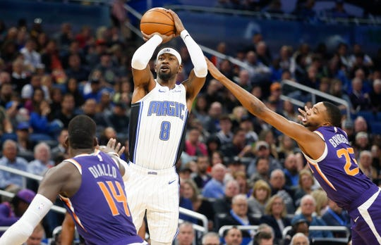 Dec 4, 2019; Orlando, FL, USA; Orlando Magic guard Terrence Ross (8) shoots over Phoenix Suns forward Cheick Diallo (14) and  forward Mikal Bridges (25) during the second quarter at Amway Center. Mandatory Credit: Reinhold Matay-USA TODAY Sports