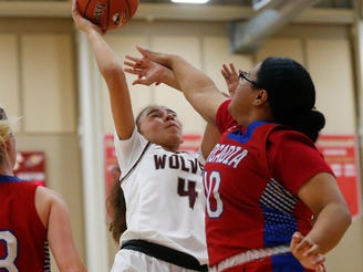 Desert Mountain's Jaedyn O'Reilly (4) is fouled by Arcadia's Anela Pulu (40) during the 7th Annual Hoophall West in Scottsdale December 4, 2019.