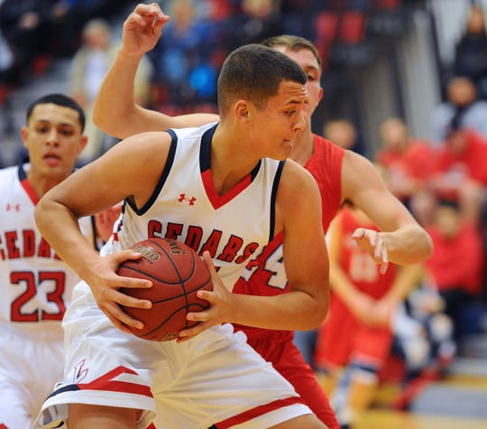 Lebanon's Isaiah Rodriguez looks for scoring room in a game against Red Land last season.