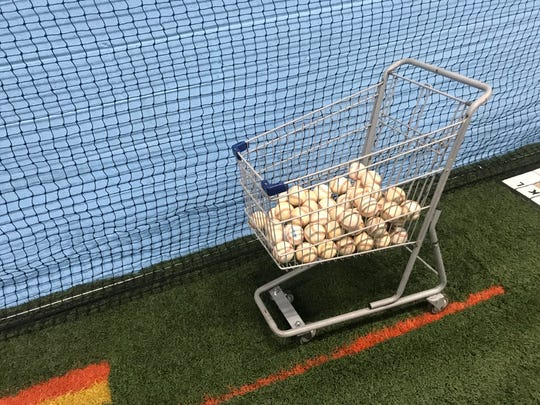 A shopping cart filled with baseballs is one sign that a Champ's Performance Training is soon to open at 1349 Cumberland Street.