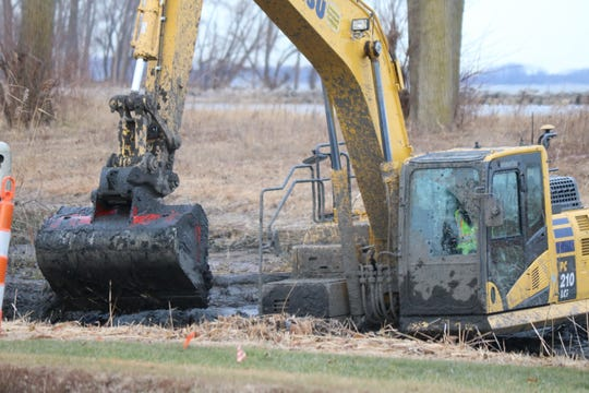 Crews are getting deep in the mud along Port Clinton's Lake Erie shores — literally — as they work to continue the excavation of the future wetlands near Waterworks Park.