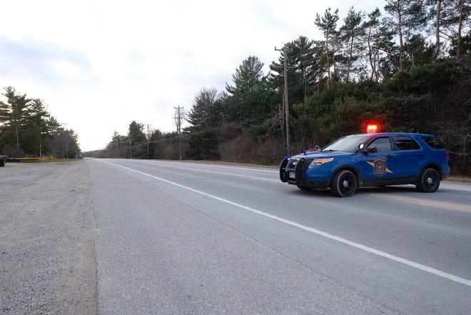 A Michigan State Police trooper blocks Gratiot Avenue near Werner Road following a fatal crash in Columbus Township.