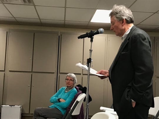 Ruth Habalewsky listens while her husband, Marty Habalewsky, voices concerns during a public hearing at Palmer Park Recreation Center on Dec. 4, 2019.