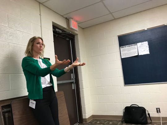 Jenifer Dixon, Air Quality Liaison for EGLE's Environmental Support Division, speaks during an informational session at Palmer Park Recreation Center on Dec. 4, 2019.
