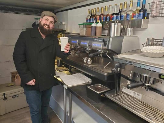 Dave Peters, co-owner of Lexington Coffee Co., poses for a photo in the coffee shop's new coffee truck M-25.