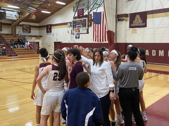The Arlington girls basketball team breaks its huddle after a timeout during its game Wednesday against Ursuline.