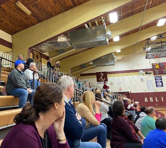 Spectators look on Wednesday evening as the Arlington High School girls basketball team hosted Ursuline.