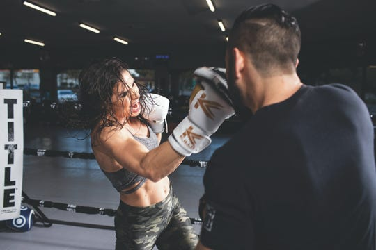 Danyelle Wolf, left, throws a punch during training.