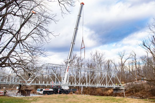 A historic bridge in York County's rural Washington Township was hoisted back into place Thursday after being removed for repair.