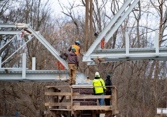 Construction workers slowly lowered the bridge, built in 1896, back into place so it could be lined up perfectly.