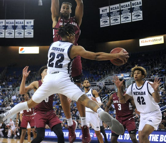 Nevada's Jazz Johnson drops off a pass to K.J. Hymes (42) during the Wolf Pack's win over Santa Clara on Wednesday.