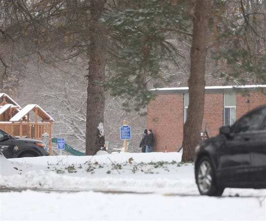 Monroe County sheriff's deputies surround Rochester Christian School in Penfield on Dec. 5, 2019, after gunshots were reported in a wooded area near the school.