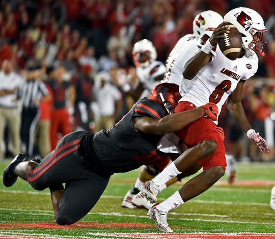 Louisville quarterback Lamar Jackson (8) is sacked by Houston defensive tackle Ed Oliver during the first half of an NCAA college football game, Thursday, Nov. 17, 2016, in Houston. Oliver and Jackson will meet again on Sunday when the Buffalo Bills host the Baltimore Ravens.