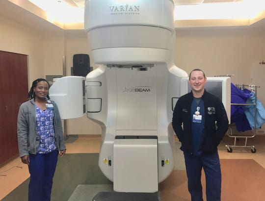 Radiation therapists Keisha Branwell and Christopher Hill in a radiation room in the Radiation Oncology Department at Highland Hospital.