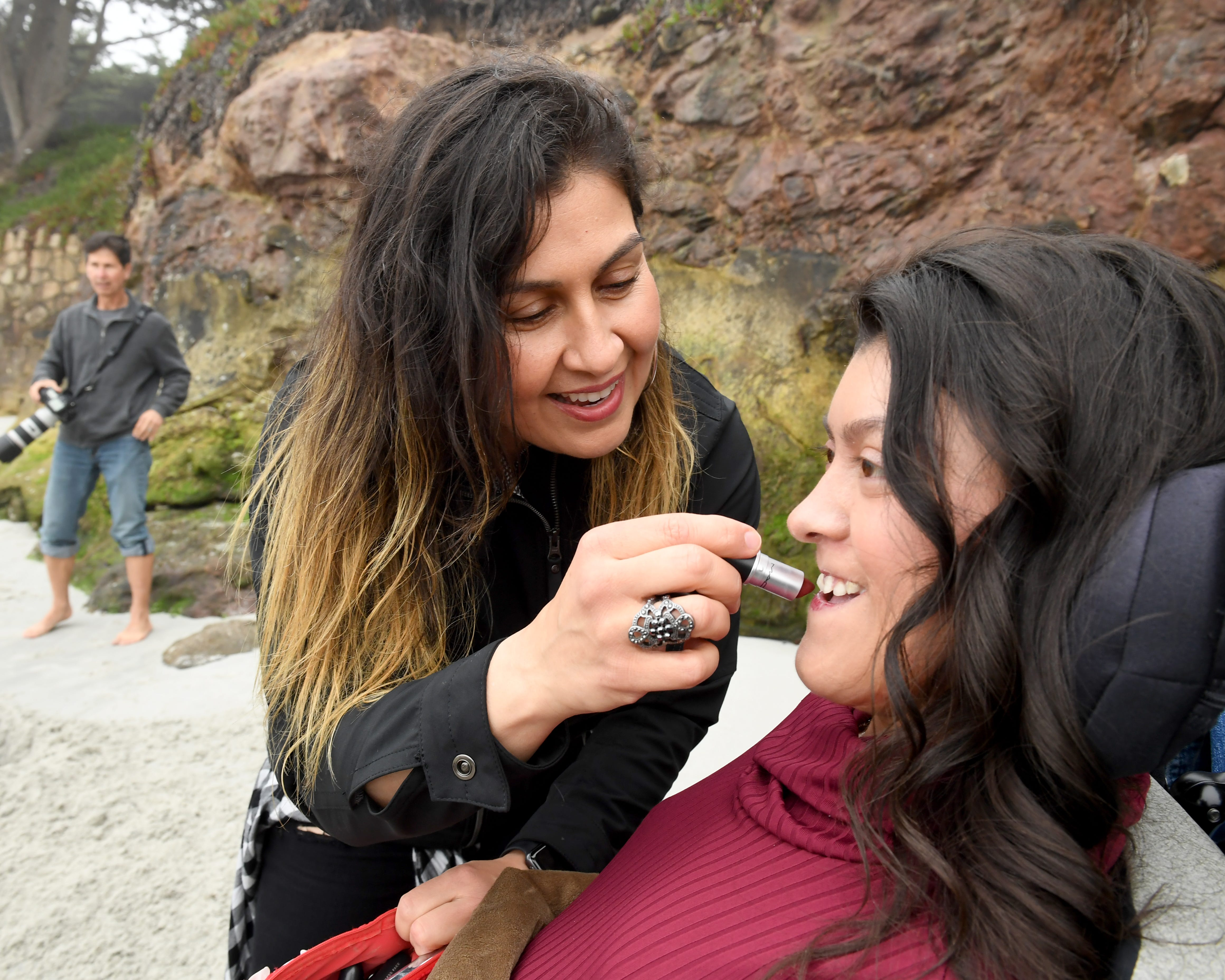 Maribel Vargas applies lipstick for her daughter Karizma at Carmel State Beach as they get ready to take graduation photos April 19, 2019.