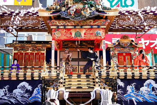 In this Tuesday, Dec. 3, 2019, photo, local residents perform kabuki inside a float for the Chichibu Night Festival in Chichibu, Japan. This two-day festival has its roots in an older tradition of villagers giving thanks to the nearby mountain god for helping them during the planting and harvesting season, according to the chief priest of the shrine.