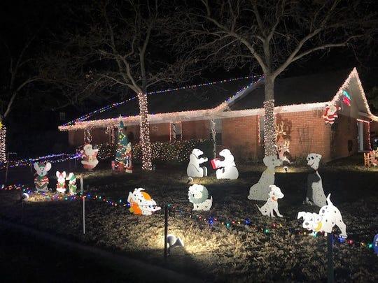 Yard at 1501 S. Jackson street with wood displays of polar bears, Dalmatians and Santa.